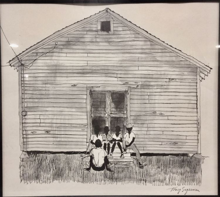 Five African American children are sitting in front of a house that without any windows suggests pverty in the southern United States